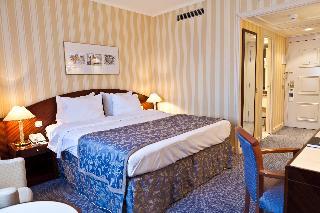 Le Chatelain Hotel - Zimmer