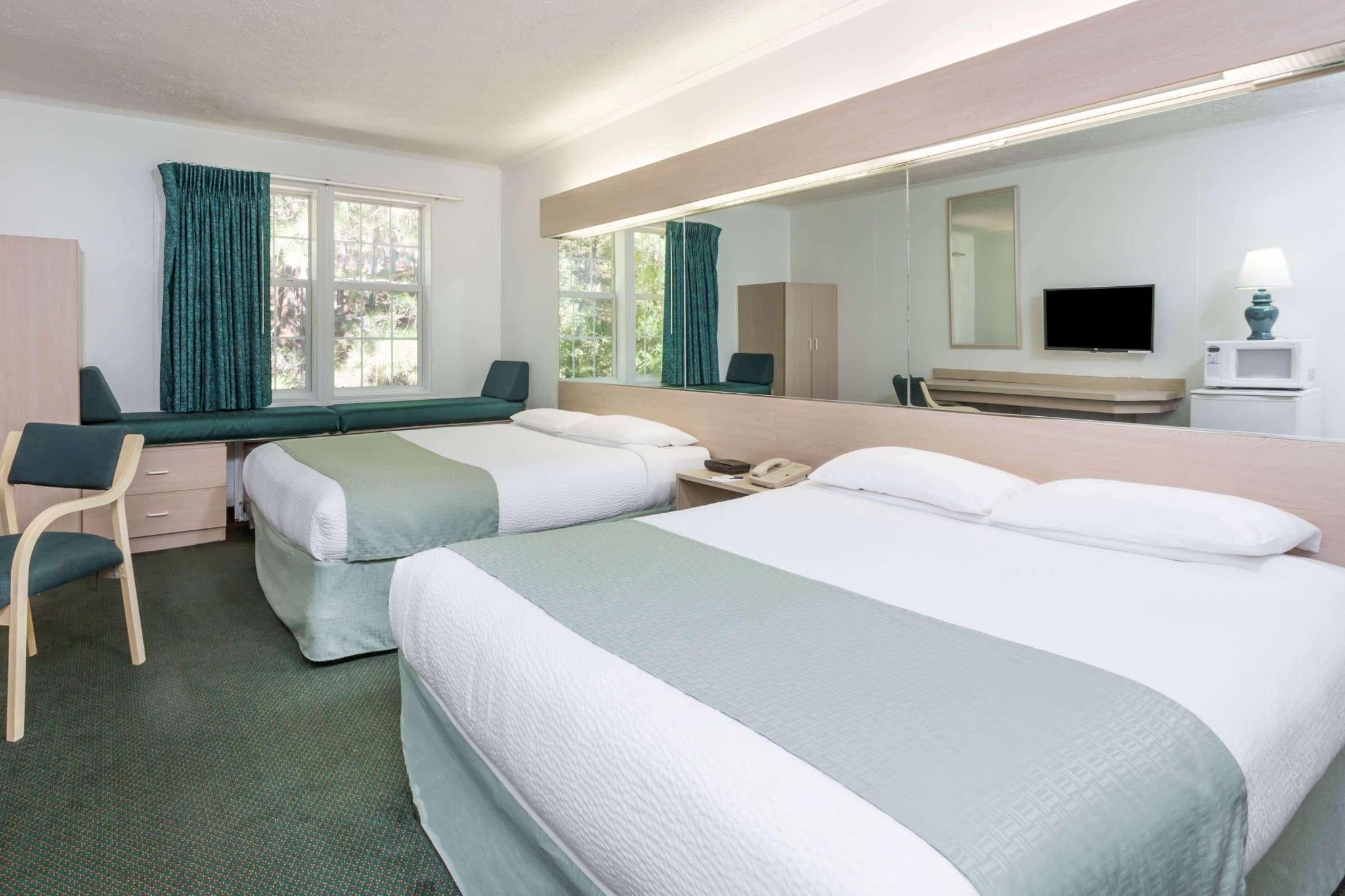 Quadruple two queen beds