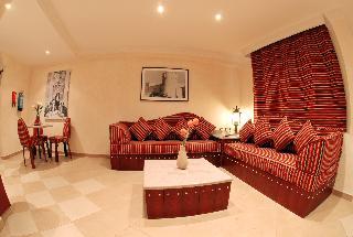 Al Liwan Suites - Zimmer