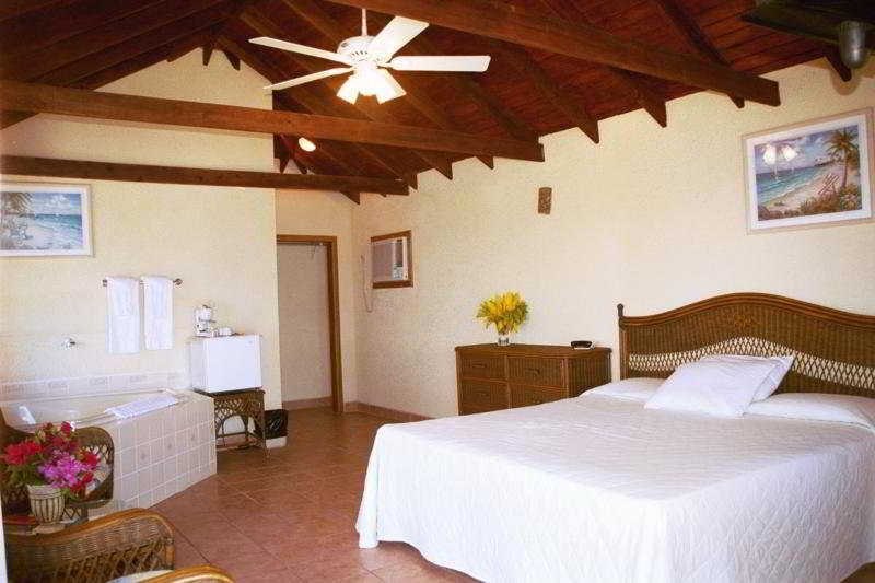 Exotic Caye Beach Resort - Zimmer