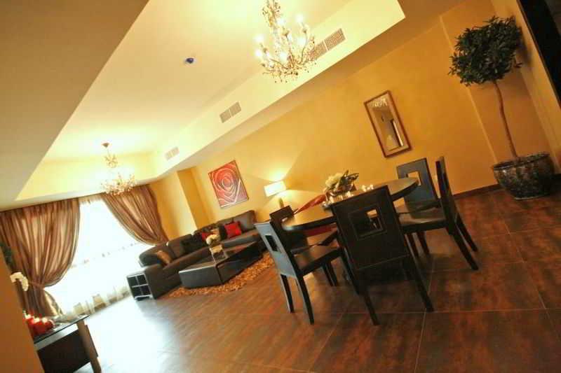Al Manzil Suites - Zimmer