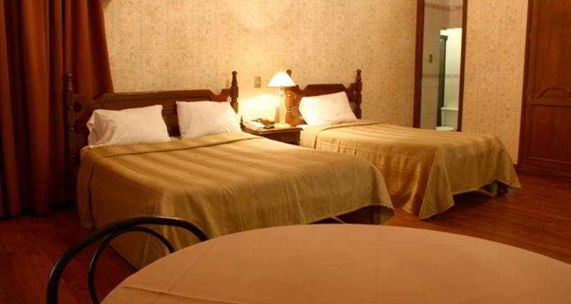 Capital Plaza Hotel - Zimmer
