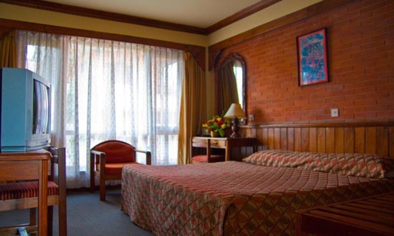 Nirvana Garden Hotel - Zimmer