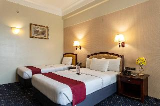 Sarrosa International Hotel and Residential Suites - Zimmer