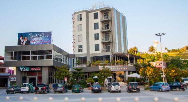 Vlora Hotel, Justin Godar 1,1