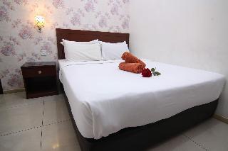 Rose Cottage Hotel Taman Perling - Zimmer