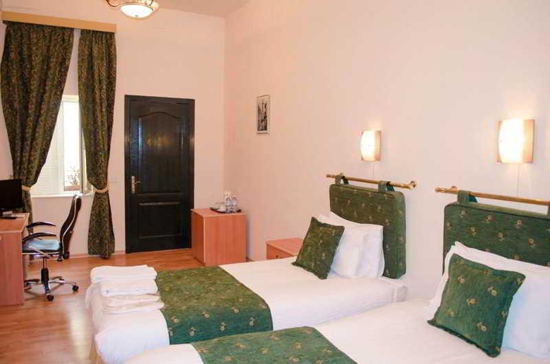 Old City Inn Hotels - Zimmer