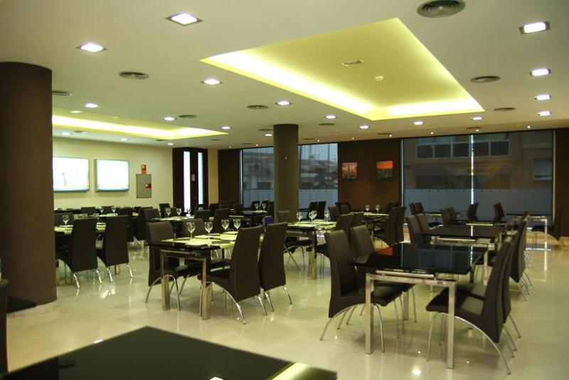 Restaurant Exe Cunit Suites & Spa
