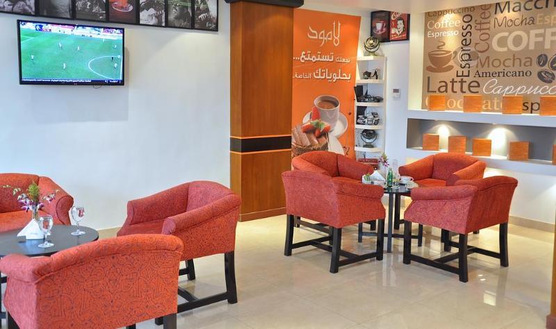 Golden Tulip Hotel Qasr Al Nasiria - Bar - 1