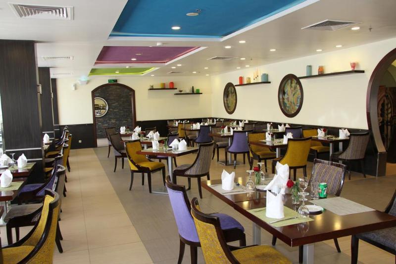 Golden Tulip Hotel Qasr Al Nasiria - Restaurant - 11